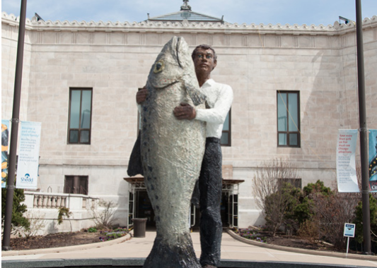 Fish In Arms Statue